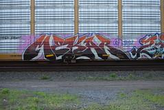 MEKAR (TheGraffitiHunters) Tags: auto street red orange white black art car train graffiti colorful paint purple tracks spray rack carrier freight autorack benched mekar benching