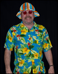 Hawaiian shirt and a daft hat. (CWhatPhotos) Tags: pictures camera summer sun holiday man silly color colour male colors hat shirt that lens beard fun photography foot prime hawaii goatee glasses cool shoes colours foto bright image artistic time pics pair hula picture hats pic olympus images shades wear ox have mans photographs photograph ii fotos mens hawaiian colored coloured daft which 45mm mk multi contain omd hawai hol hawiian em10 dafty cwhatphotos
