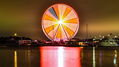 #24/52 National Harbor ferris wheel blurred and boats (PJMixer) Tags: family night river boats washington nikon motionblur ferriswheel 52weekproject nationalharbor dogwood52 dogwoodweek24