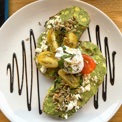 Smashed avocado on toast for breakfast at Urban Providore in South Yarra