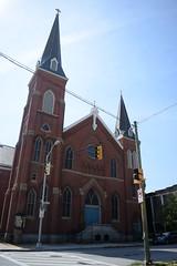 Baltimore Church (Sam DeGenova) Tags: baltimore buildings city cars sun shine reflections people street america