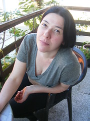 Nina on a Balkan Balcony (seanfderry-studenna) Tags: pink summer people woman plants brown green girl beautiful beauty face shirt lady female fence pose dark hair outside person amazing eyes hands chair girlfriend long day sitting married arms time outdoor balcony gorgeous posed posing sunny charm lips veranda shade stunning wife nina brunette charming seated tee balkan fiancee
