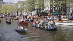 Boating at Amsterdam Canal (Stphanie`s dad) Tags: holland amsterdam canal boating queensday koninginnedag