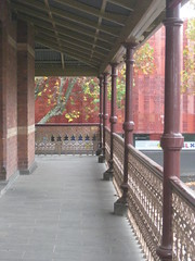 The Verandah of the Former Ballarat Police Station and Barracks - Camp Street, Ballarat (raaen99) Tags: city roof building brick stone architecture facade iron balcony wroughtiron pillar 19thcentury victorian australia victoria victoriana column elevated verandah residence policestation lawandorder 1886 ballarat goldrush bluestone victorianarchitecture balustrade redbrick banding nineteenthcentury fretwork 1880s countryvictoria campstreet policedepartment civicbuilding constabulary lacework policeforce victorianbuilding clinkerbrick policebarracks campst doublestorey goldrushera brickandstone provincialvictoria wroughtironlacework wroughtironfretwork wroughtironbalustrade featurebrick bluestonepitcher ballaratpolicestation ballaratpolicebarracks