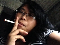 Smoking (mikeeliza) Tags: b shadow red woman brown sunlight black hot girl beautiful mouth hair asian glasses pretty skin cigarette young smoking burning filipina smoker ashe runette mikeeliza