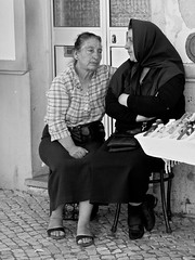 an intimate chat (tayl0439) Tags: street old bw woman white black portugal women chat fuji candid talk lagos fujifilm algarve peddler talking portuguese seller x10