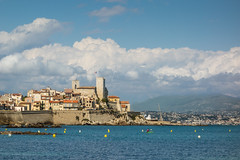 Antibes [Explored #10] (Jawad - busy then away!) Tags: sea holiday france water clouds landscape nice flag canoe explore cumulus provence oldtown antibes buoy alpesmaritimes bayofangels explored rx100 labaiedesanges sonyrx100 sonycybershotrx100