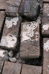 Closeup of what I initally thought were bricks or cobblestones.  These are sections or railroad tie that are arranged together to create the floor of this large building. (tomman) Tags: wood old railroad yards urban yard train foundry factory floor decay albuquerque rail tvshowlocation railyard boiler filmlocation revitalize macgruber breakingbad terminatorsalvation