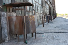 The steel partitions provide privacy for each of the urinal stations outside (tomman) Tags: railroad yards urban yard train foundry factory decay albuquerque rail tvshowlocation railyard boiler filmlocation revitalize macgruber breakingbad terminatorsalvation