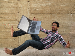 (OwaisPhotography (www.facebook.com/owaisphotos)) Tags: people motion speed asian fly jump nikon technology action laptop levitation coolpix pakistani float p80 pakistaniethnicity owaisphotography gettyimagespakistanq12012 gettyimagesmiddleeast