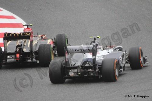 Romain Grosjean passes Valtteri Bottas in Free Practice 1 at the 2013 Spanish Grand Prix