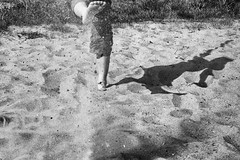 Kicking the sand (jochem.herremans) Tags: shadow sun playing feet beach sand child antwerp kicking antwerpen