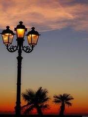 Trois... (anton) Tags: sardegna tramonto nuvole mare sardinia cielo poesia dedica palme amore lampioni controluce alghero romanticismo anton angolidisardegna troisallumettesdiprevert