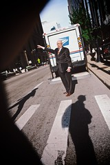 Man hails a taxi (vonderauvisuals) Tags: from street old city light urban chicago man guy up canon lens wonder photography drive waiting shoot mood shadows hand looking cross shot angle post bright walk candid cab taxi air watching wide perspective bald strangers sigma center dude business suit rush hour transportation processing service metropolis glowing around postal feeling mm visuals hip aging vignette tone sticking 6d chicagoist hailing 2470 hails waiving vonderau