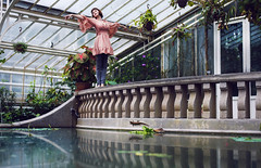 greenhouse-dancing (laura zalenga) Tags: light woman plant reflection green leave water glass girl stone pose dance branch dress greenhouse railing laurazalenga
