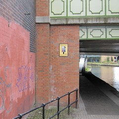 Urban Splash (bartholmy) Tags: uk bridge streetart river poster manchester graffiti bricks tags banister brcke fluss plakat irwell gelnder ziegel salesoffice overpainting bermalung