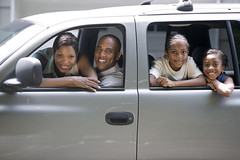 Family in Their SUV --- Image by  Royalty-Free/Corbis (anchor1203) Tags: family girls portrait people men love parenthood boys children outdoors photography parents togetherness women eyecontact affection weekend colorphotography daughters posed roadtrip passengers mothers vehicles few transportation africanamericans americans blacks males females copyspace humanrelationships traveling groupportrait adults optimism fathers offspring sons headandshoulders midadult midadultman motorvehicles sportutilityvehicles headandshouldersportrait midadultwoman 79years 3035years 30sadult 56years 3540years