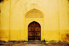 Doors at Jantar Mantar, Jaipur, India (Seven Seconds Before Sunrise) Tags: door travel india yellow asia lock unescoworldheritagesite dirt padlock jaipur rajasthan jantarmantar pinkcity southasia