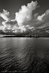 Bridge Over The Columbia (Jim Lundgren Photography) Tags: road longexposure travel bridge usa monochrome oregon us blackwhite washington unitedstates scenic dramatic monotone monochromatic columbiariver journey transportation astoria pacificnorthwest us101 steeltrussbridge astoriameglerbridge