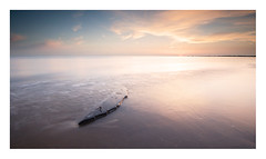 Adrift (A-D-Jones) Tags: wood sun seascape beach set clouds landscape sand warm long exposure waves angle wide floating splash drift crosby merseyside sefton hightown blundellsands