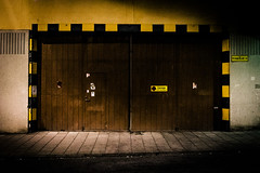 Door in wall (Fredrik Forsberg) Tags: door port warning dark evening sweden stockholm dusk canonfd28mmf28 nex6