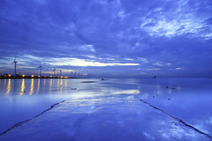 the blue way (Thunderbolt_TW) Tags: sunset sea sky sun reflection water windmill canon landscape taiwan  getty    windturbine gettyimages  changhua       hsienhsi   changpingindustryarea hybai
