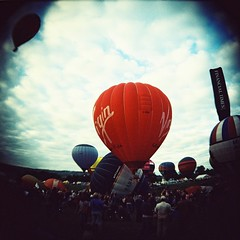 Balloon Fiesta 2013 Roll 1 (Cris Ward) Tags: show uk party summer sky cloud colour 120 6x6 film up festival analog vintage mediumformat circle bristol square toy outdoors flying holga lomo xpro lomography crossprocessed fuji fiesta bright britain crossprocess balloon toycamera flight wide vivid wideangle slide exhibition plastic squareformat crossprocessing gathering hotairballoon fujifilm analogue colourful expired vignetting fujichrome ultrawide provia e6 vignette viewfinder holga120cfn c41 400f cfn colourshift fujichromeprovia400f darkcorners lomographyuk bristolballoonfiesta2013