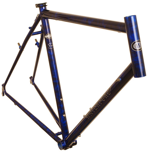 <p>Front view of Waterford 14-Series Adventure Cycle with Blue Smoke Job.  The Adventure Cycle is the choice for cross-country unsupported touring, with construction for load carrying, a fit for long-distance comfort and plenty of braze-ons for racks, fenders and water bottles.  This one has a cool candy smoke paint job to boot, plus the classic block style black with silver Waterford decals.</p>
