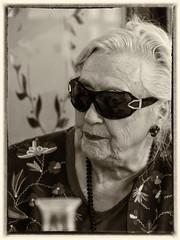Une femme d'un certain ge (Reinardina) Tags: portrait people woman sunglasses sepia person one glamour candid shades blond age single monchrome