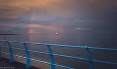 Rainbow Fence HFF (montrealmaggie) Tags: blue sunset sea seascape colors beauty fence rainbow ship