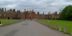 In front of the palace (southglosguytwo) Tags: 2016 bankholidaymonday building cameraphonephoto cloudy hamptoncourtpalace may sky spring variouspeople avenue tree