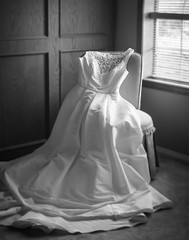 Anticipation (Evelyn Ford) Tags: wedding blackandwhite white window bride beads lace naturallight sequins weddingday bridalgown ef50mmf12lusm canoneos5dmarkii