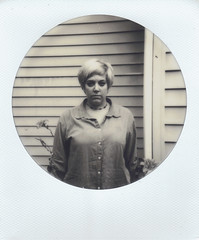 Day 053 (H o l l y.) Tags: impossible project polaroid circle frame no color bw black white self portrait house architecture flowers plants girl blond fashion retro indie vintage