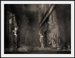 laneway figures II (Andrew C Wallace) Tags: city streetart blur sepia lensbaby ir photography dof bokeh streetphotography australia melbourne victoria tourists pedestrians infrared cbd laneway figures hosierlane tiltshift m43 nikon50mmf14 microfourthirds tilttransformer olympusomdem5