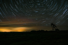 oil rig (CassinStacy) Tags: trees sky nature night clouds stars star evening desert trails astro machinery astrophotography rig oil