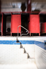 Cubicle Gloom (stoneleighboy) Tags: urbex dereliction govanhill atmosphere history pool baths building socialarhitecture nikon interior red glasgow lensbaby