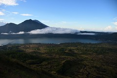 Half-way down from Mount Batur in Indonesia after the sunrise. (Nam__b) Tags: blue sky bali cloud mountain lake green nature contrast trekking indonesia landscape nikon outdoor hiking clear mount nikkor d500 lakebatur kintamani mountbatur afsdxnikkor18200mmf3556gedvrii