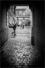 Lurking in Lancaster (Mister Oy) Tags: street blackandwhite bw monochrome mono alley streetphotography fujifilm passing davegreen x100 oyphotos fujix100