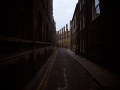 Photo (Daniel Pietzsch) Tags: street uk houses cambridge england man lumix alley photos g chimneys dmcgf1 14f25 lumixg14f25