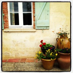 Window and Flower Pots (MarketingBarefoot) Tags: flowers stone french path antique terracotta books pots barefoot shutters ambassadors stucco
