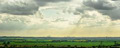 LONDON SKYLINE (shoeymcmooey) Tags: trees sky sun flower green london nature sunshine weather bicycle skyline clouds 50mm bokeh f14 sony thecity 50mm14 naturereserve sunrays essex londonskyline nex laindon 5n minolta50mmf14md nex5n sonynex5n laindonnaturereserve