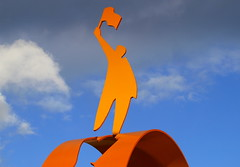 Signal Man sculpture in Wolverhampton (Tony Worrall Foto) Tags: old uk england urban sculpture orange man art station train cutout outside outdoors artist arty flag statues wave railway created made figure publicart celebrate own artworks midlands wolverhampton sculpt grandstation gilespenny 2013tonyworrall