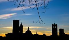Sunset in Bergamo (fede_gen88) Tags: blue winter sunset sky tree tower church silhouette yellow nikon day branch cityscape bell bare steeple clear campanile bergamo lombardia lombardy uppercity bergamoalta cittàalta d5100