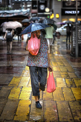Street Fashion (briyen) Tags: street city people urban hat rain umbrella hong kong shopper