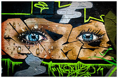 Blue Eyes (ta_photografik) Tags: blue streetart green face eyes looking mask blueeyes cracks staring grafittiart