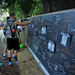 Students leave notes on a chalk board at the All Carolina Meal outside Fountain Dining Hall.