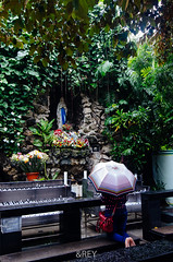 Praying In The Middle of Rain (Andrey Eko) Tags: rain indonesia nikon catholic cathedral maria mary pray praying mother jakarta bunda katolik katedral d7000 nikond7000