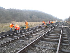 The gang move the spoil from the lineside 9Mar15