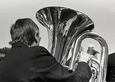 Brass Bands in Tudor Square (pho-Tony) Tags: camera blackandwhite bw music white black slr film 35mm square lens japanese reflex nikon band tudor single plus 135 nikkor rodinal brass ilford nikonfm2 brassband fm2 ilfordhp5plus fp5