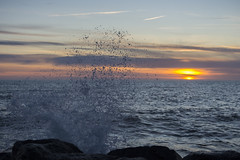 Waves crashing on rocks (G. Warrink) Tags: sea sky sun beach water denmark coast sundown wave northsea groyne